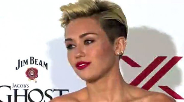 miley-cyrus-photo-criticized-by-asian-american-group-hot-nude