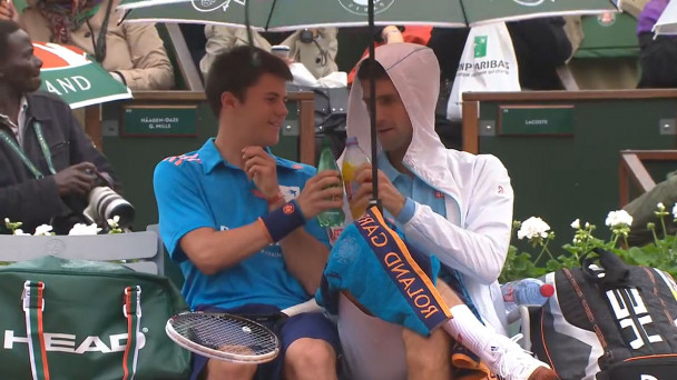 Image result for Djokovic Sharing Refreshments With The Ball Boy