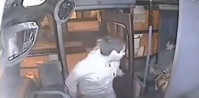 VIDEO: Would-be mugger ends up in tears after being trapped in bus door and  hit by 'hero' bus driver